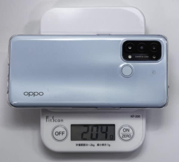 OPPO Reno5Aを標準添付のケースに入れて計量器で計測すると、204gです。